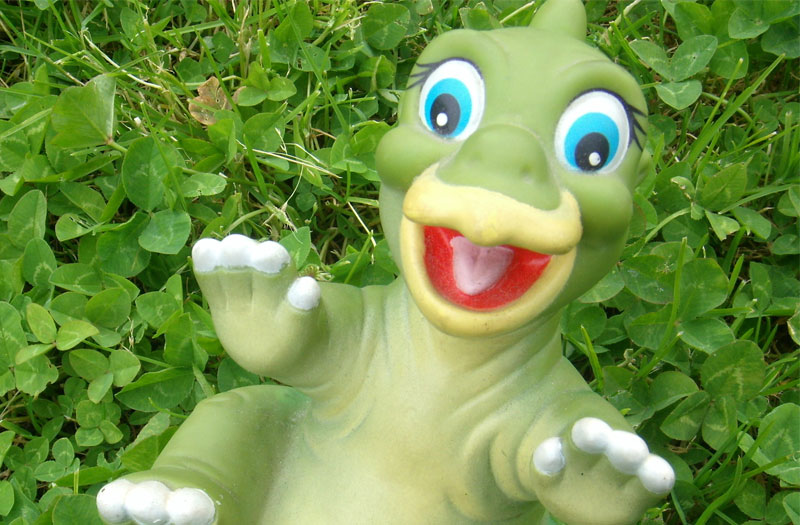 Picture of a toy dinosaur with a happy smile. It's a rogetsthesarus... get it?