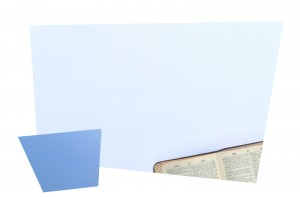 Collage of two blue skewed rectangles, with an open dictionary in the corner