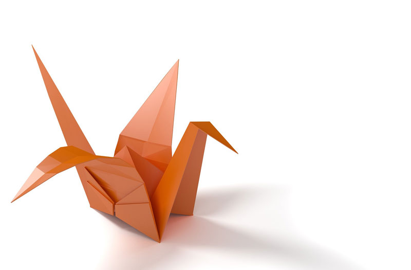 An orange origami paper crane