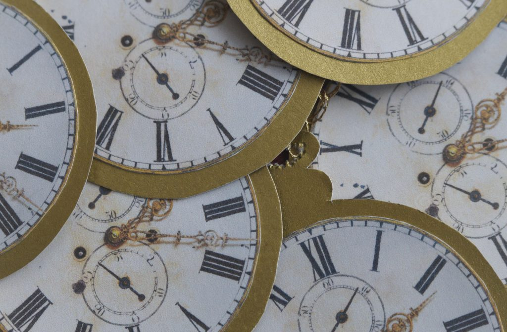 Close up image of cardboard clock faces