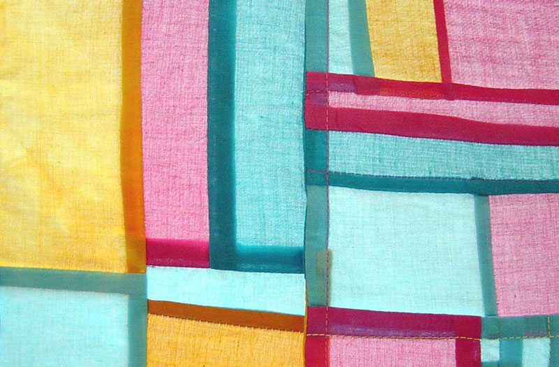 Coloured blocks of fabric sewn into an appealing structure