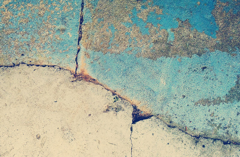 Close-up image of artfully cracked and distressed concrete