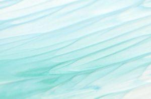 Textured blue-green paint